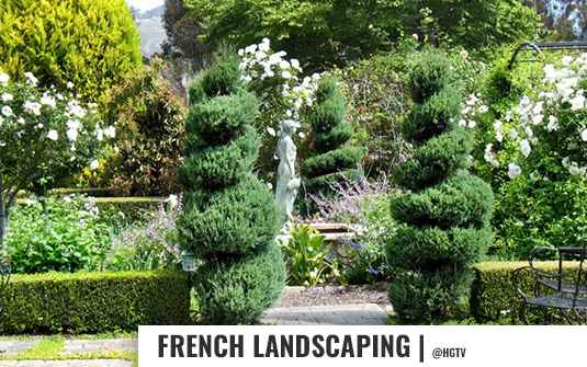 French style landscape yard with bushes, trees and flowers