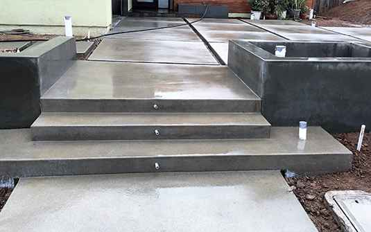 Supreme Tree Experts Hardscaping with new concrete patio steps in front entrance