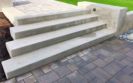 Supreme Tree Experts hardscaping designed paved stonework patio steps
